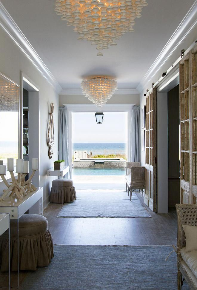 Beach house interiors interior ideas the best decor of all is view to ocean hand poured porcelain cup chandeliers were imported also design guy interiordesignguy on pinterest rh