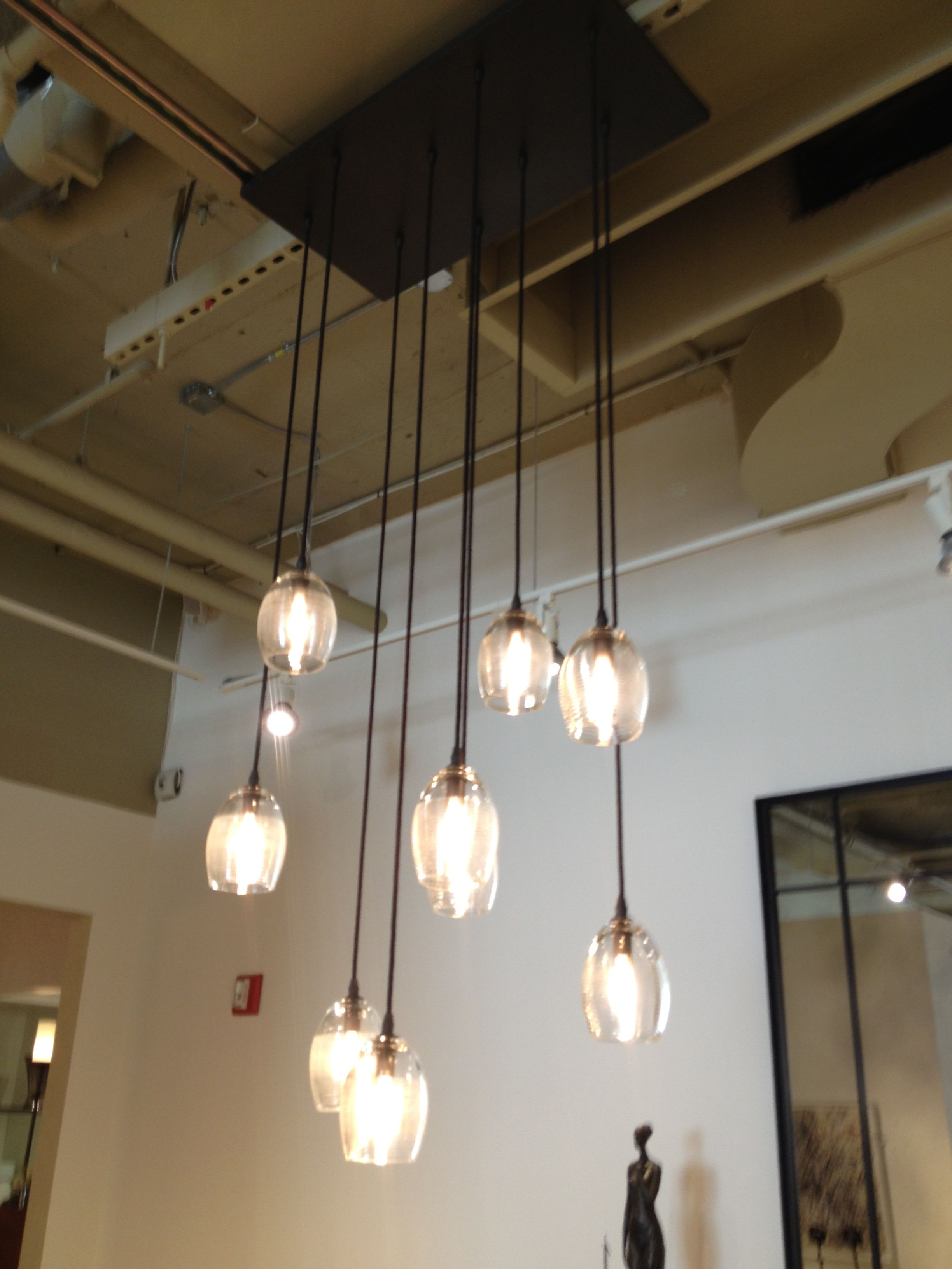 Webster co showroom photo of a custom light fixture made using the holly hunt thread by thread pendant by alison berger