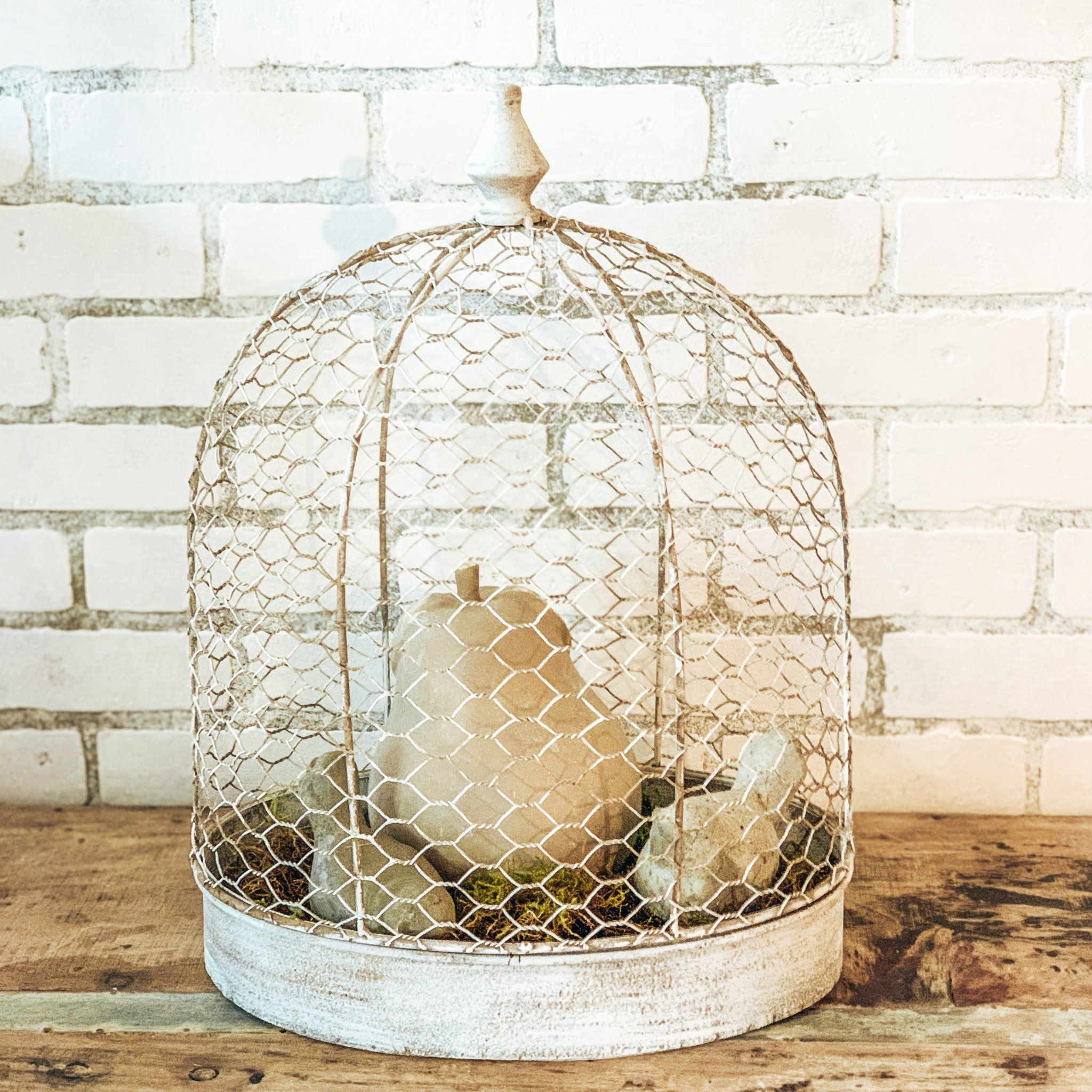 Metal White Distressed Bird Cage Bird Cage painted in a white distressed for a shabby chic cottage style. Style this piece with many options. This does not include decor.Dimensions:18.5