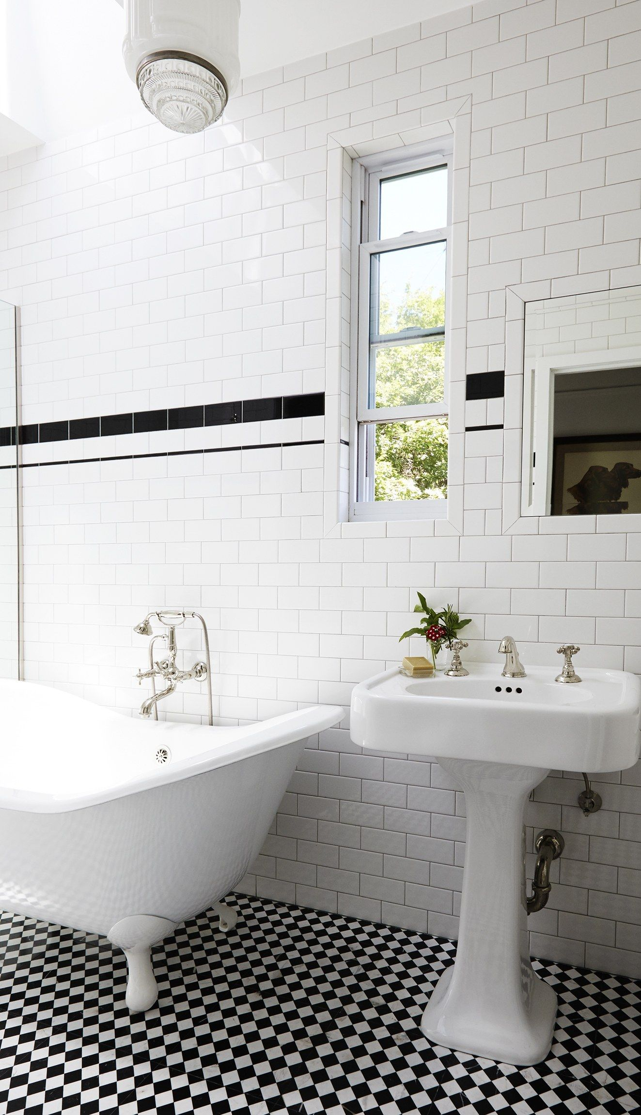 Bathroom with black and white tiled floors
