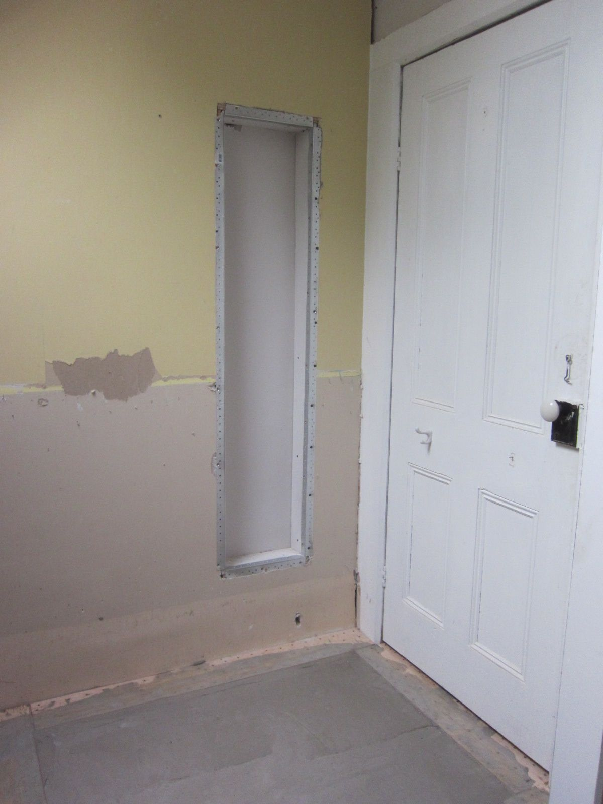 """Tiny little cupboard behind the door, it's about 4"""" deep"""