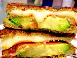 Grill cheese for grownups -   2 slices of french bread  3 slices of monterey jack cheese  1 avocado; sliced n pitted  1 tomato; sliced  salt, pepper to taste  butter   DIRECTIONs: spread butter on all slices of bread; divide the cheese n avocado evenly; heat skillet and grill on both side till nice n toasted OPTIONAL: serve with homemade tomato soup Enjoy!