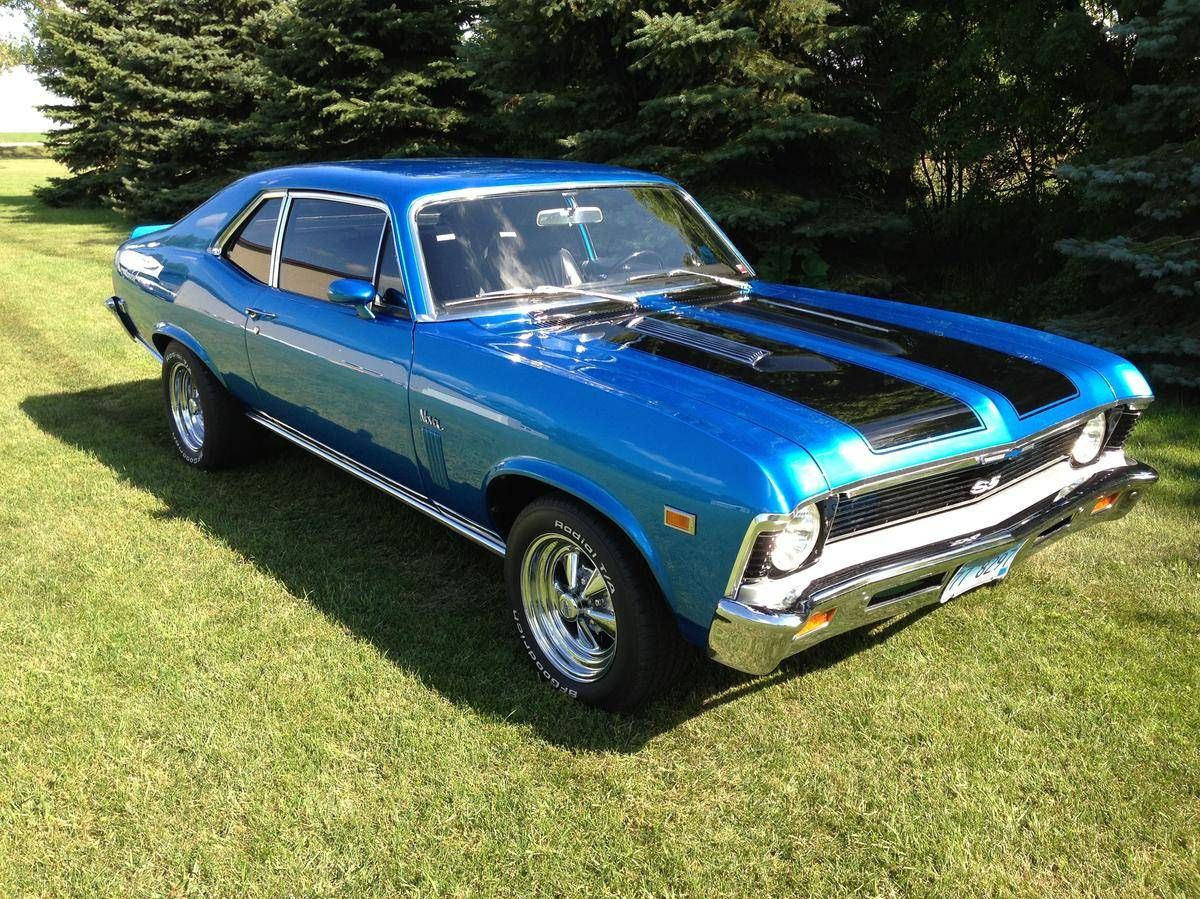 Your car a 1972 nova ss with wide black stripes on the hood and trunk similar to this