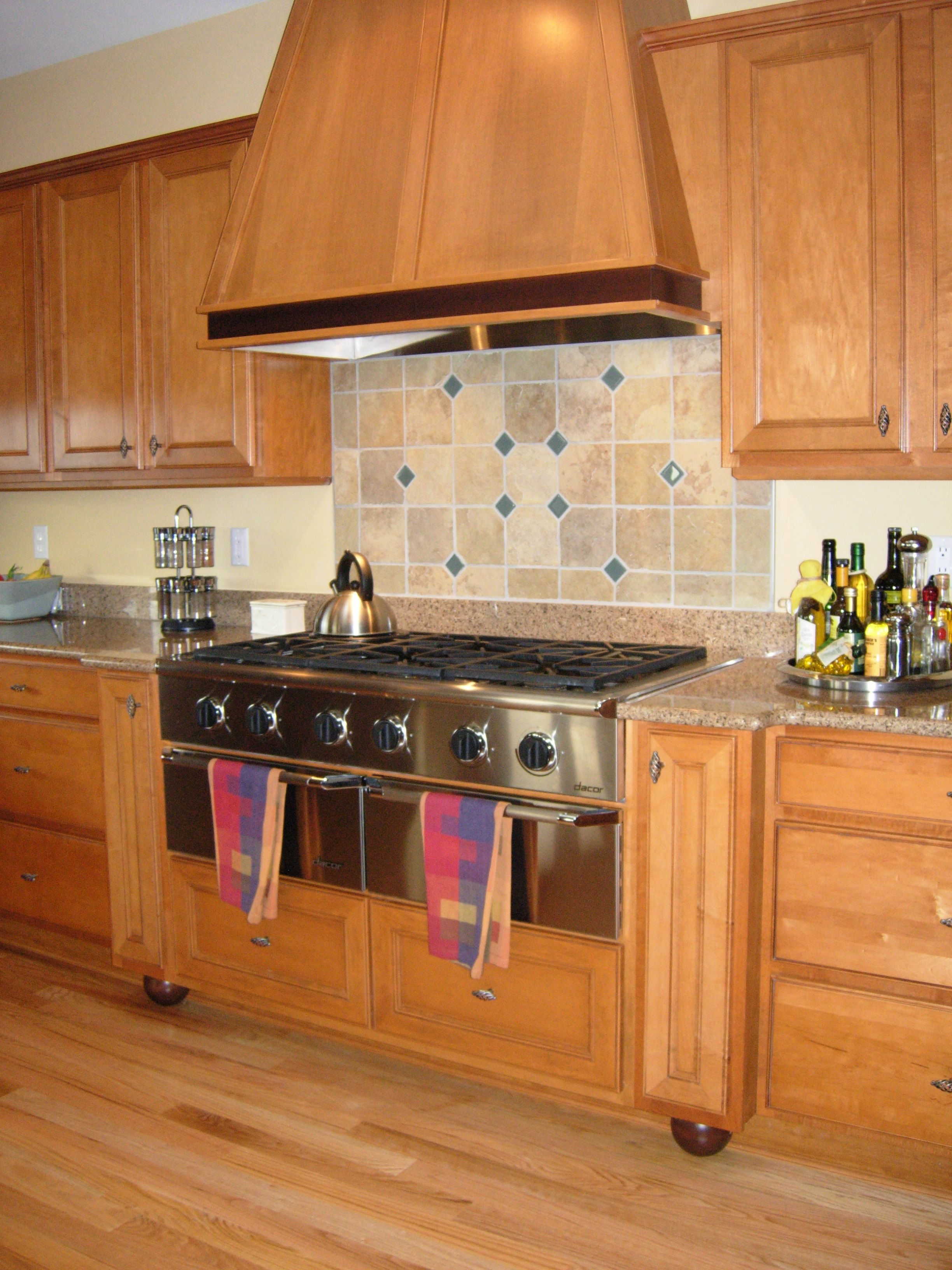 A Builder Grade Cabinet Upgraded With The Addition Of Matching Custom Range Top And Wood Hood