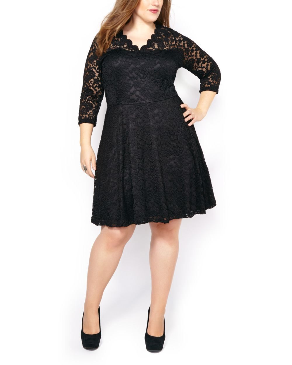 This stunning plus-size black dress blends comfort and ...