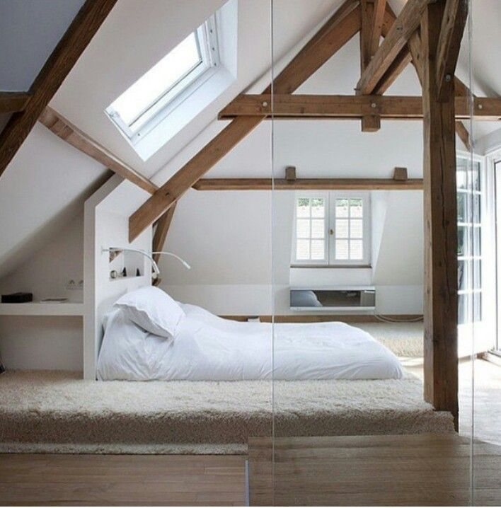 Barn with exposed beams bedroom in the