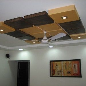 Wood Ceiling Design With Ceiling Fan And Recessed Ceiling Lights