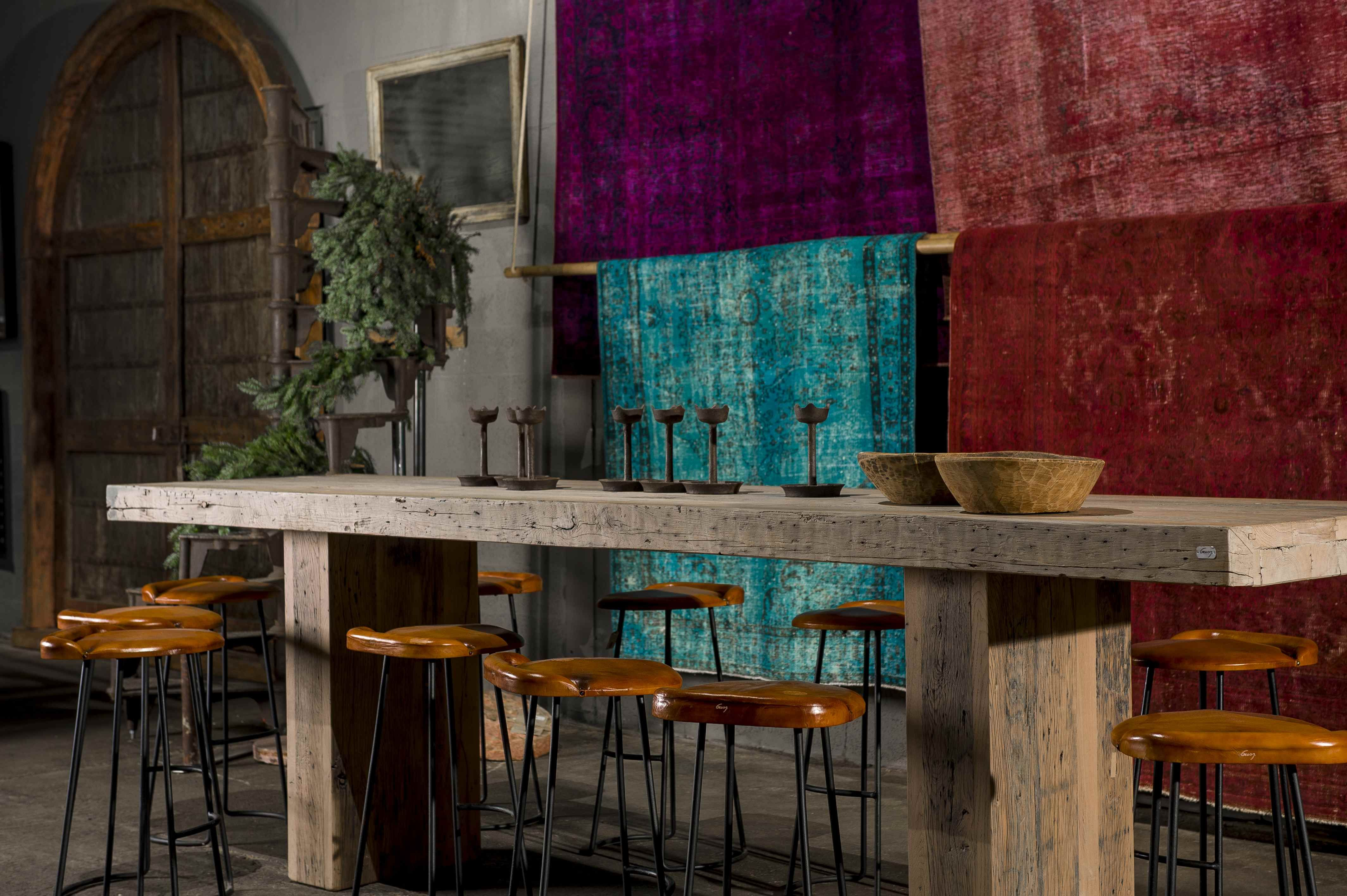 High bar table with bar stools and colourful carpets from gusj.com