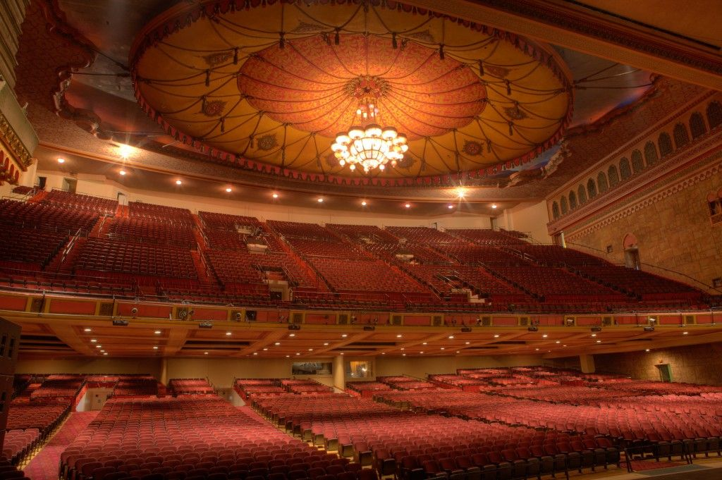 Shrine Auditorium (Interior) - Los Angeles, CA   When the Shrine opened, it was heralded as the world's largest, as was this crystal chandelier, hanging at the center of auditorium. It weighs 4 tons, measures 20' across & has 500 red, white, blue, & amber bulbs. EACH of those small round sections has 100s of crystals. When I saw it as a child I was enchanted & have never forgotten it. When the house lights were dimmed and this was the only source of light it was truly breath-taking.