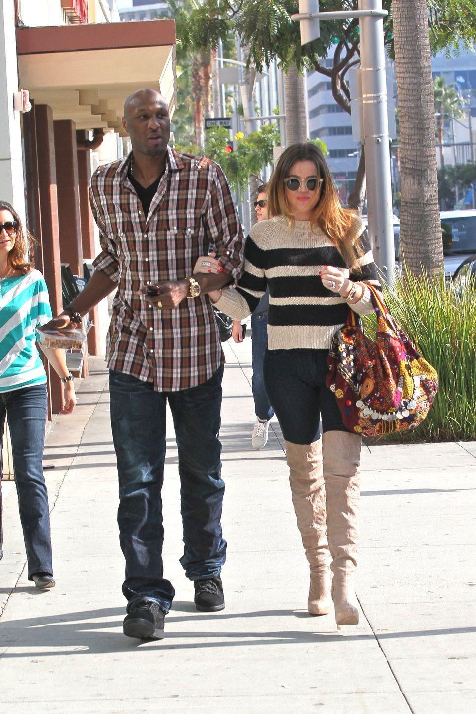 Lamar Odom Khloe Kardashian checked shirt dark jeans black sneakers beige overknee boots striped sweater pattern bag