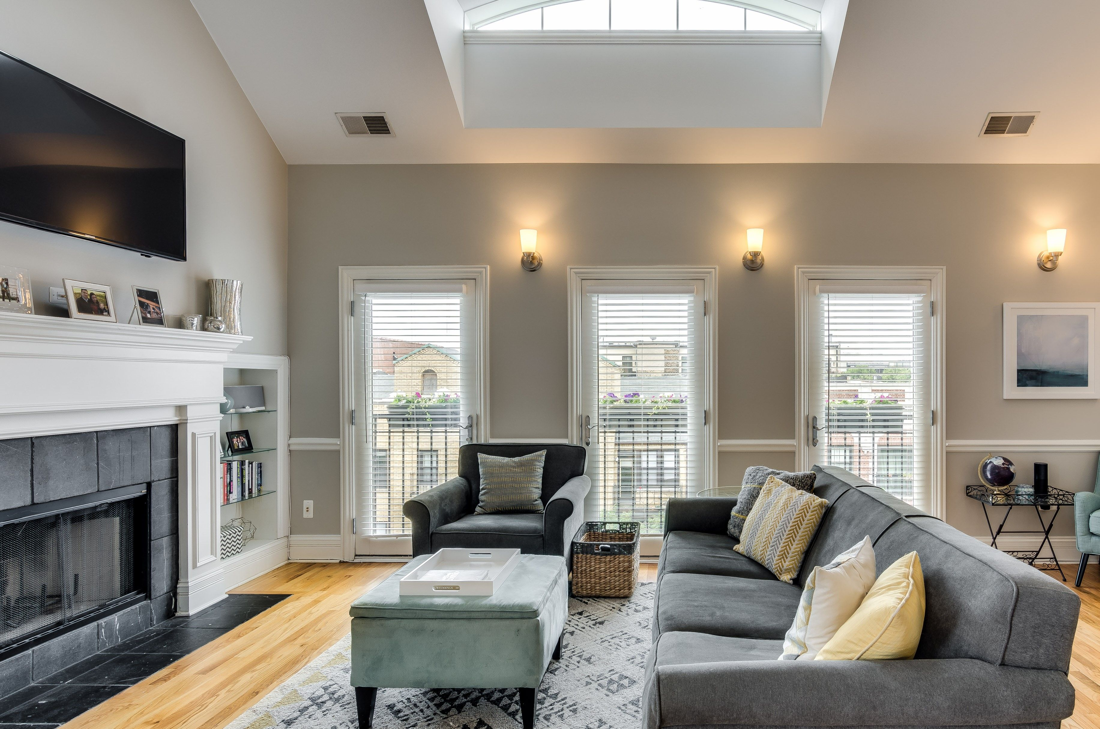 Vaulted cathedral ceilings with skylights in penthouse
