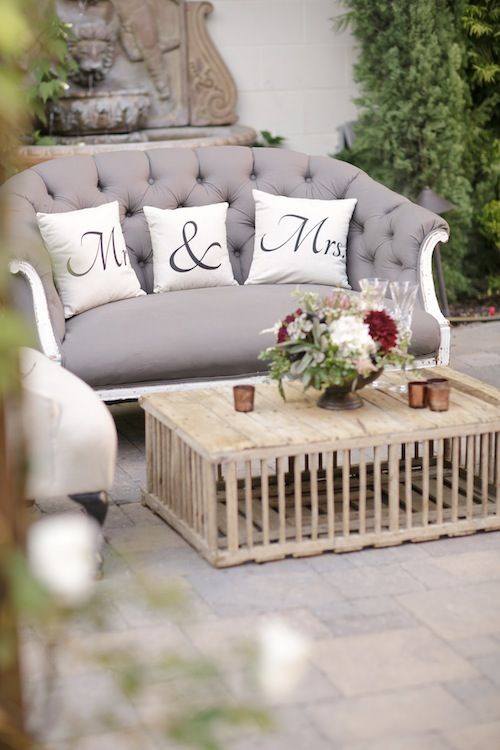 Grey button settee and wooden table at Franciscan Gardens outdoor  California wedding with Found Vintage Rentals - Grey Button Settee And Wooden Table At Franciscan Gardens Outdoor