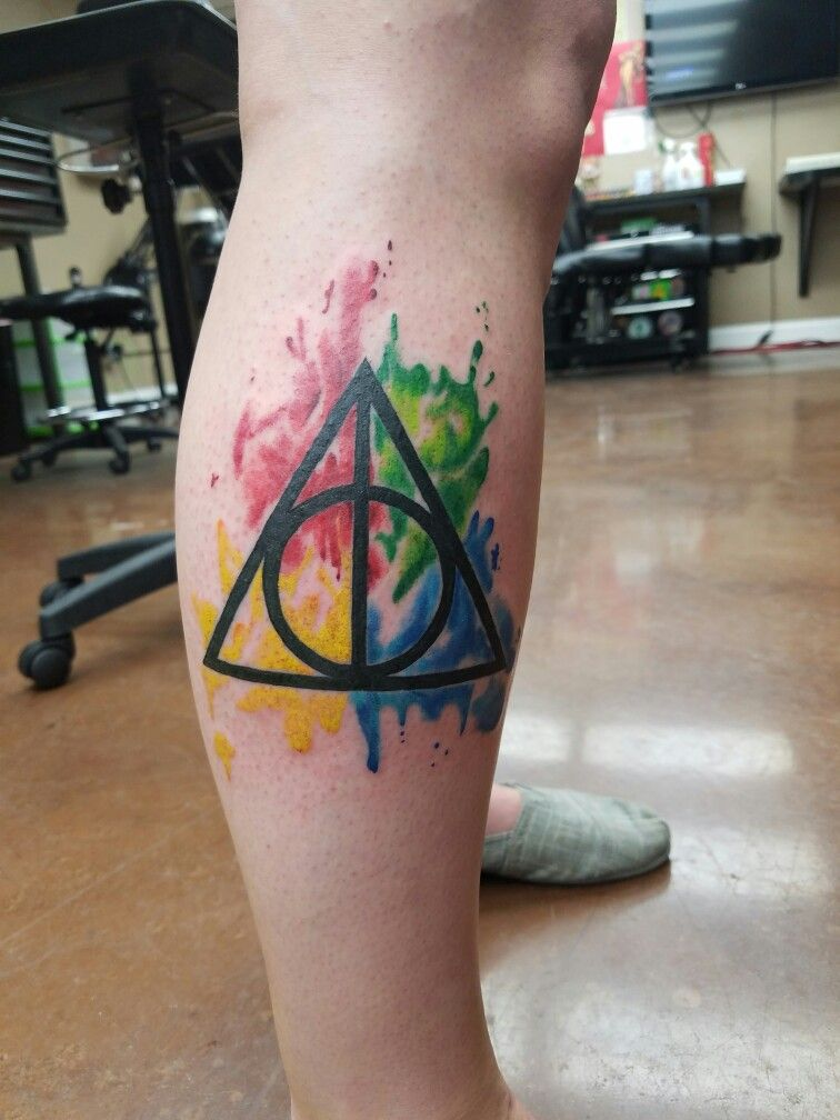 My Newest Tattoo Deathly Hallows With The Hogwarts House Colors In Watercolor Deathlyhallows Harrypottertattoo Tattoos Harry Potter Tattoos New Tattoos