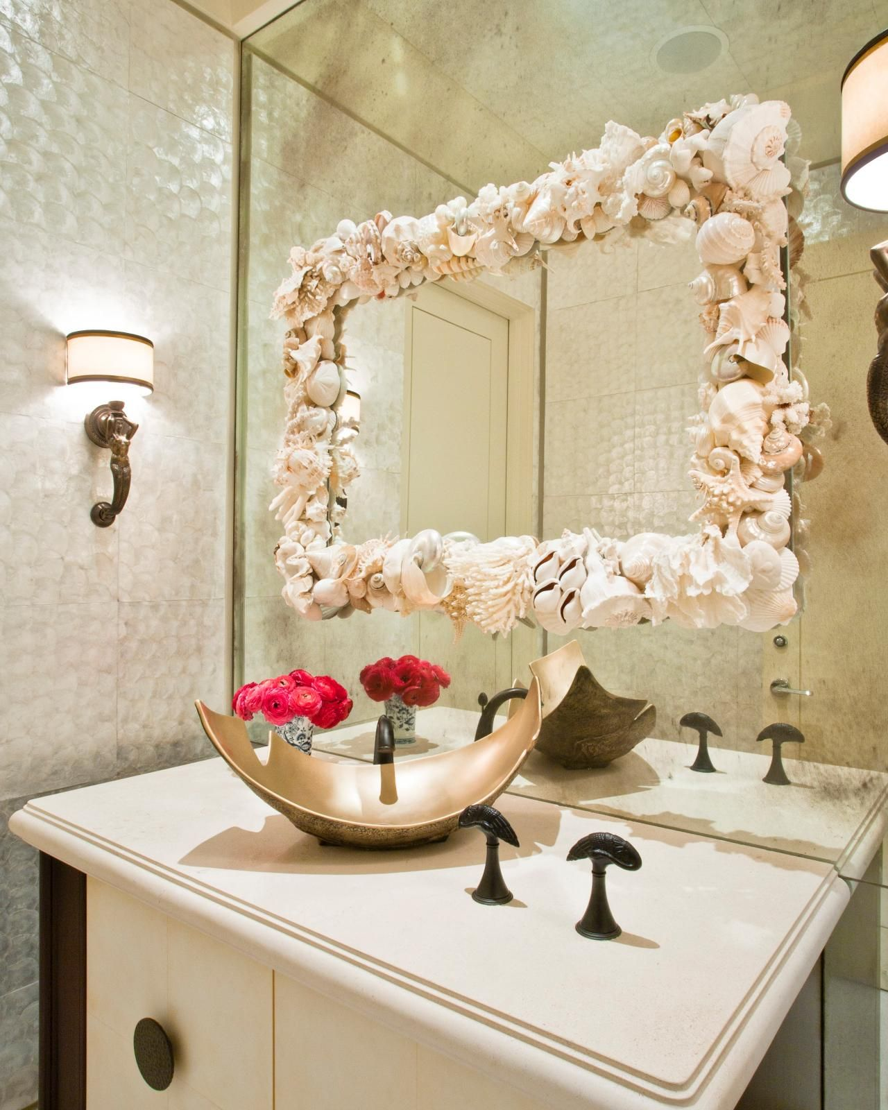 A Seashell Lined Mirror And Mermaid Shaped Sconces Lend A Coastal Vibe To  This
