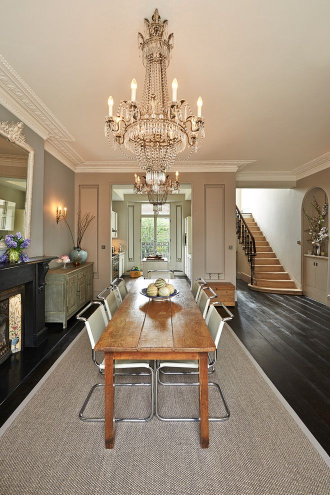 narrow dining room table chairs chandelier carpet