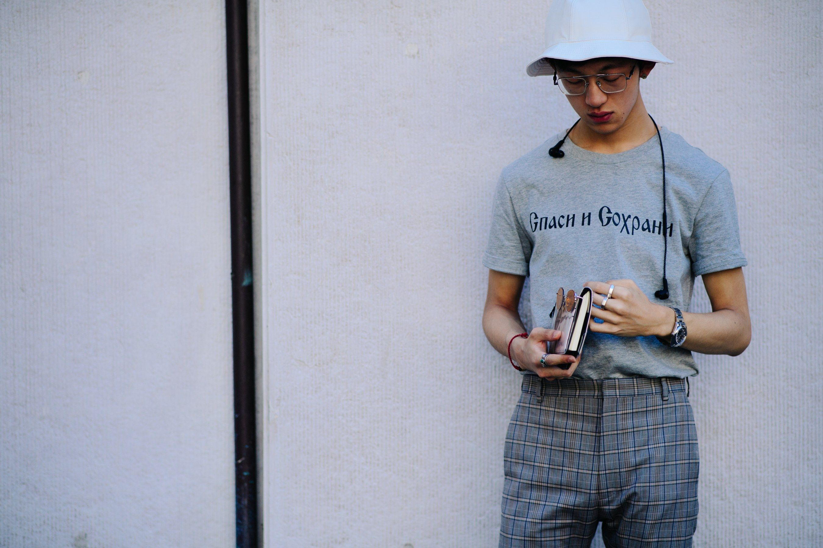 51b14da170f Fanny Packs and Bucket Hats Disrupted Milan Fashion Week s Usually Dapper  Street Style at the Spring 2018 Men s Shows Photos