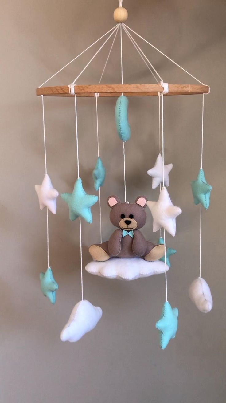 This Teddy bear felt mobile is perfect decoration for a baby boy nursery room. It will surely become a wonderfull design