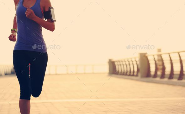 young fitness woman runner running at seaside by lzf. young fitness woman runner running at seaside...