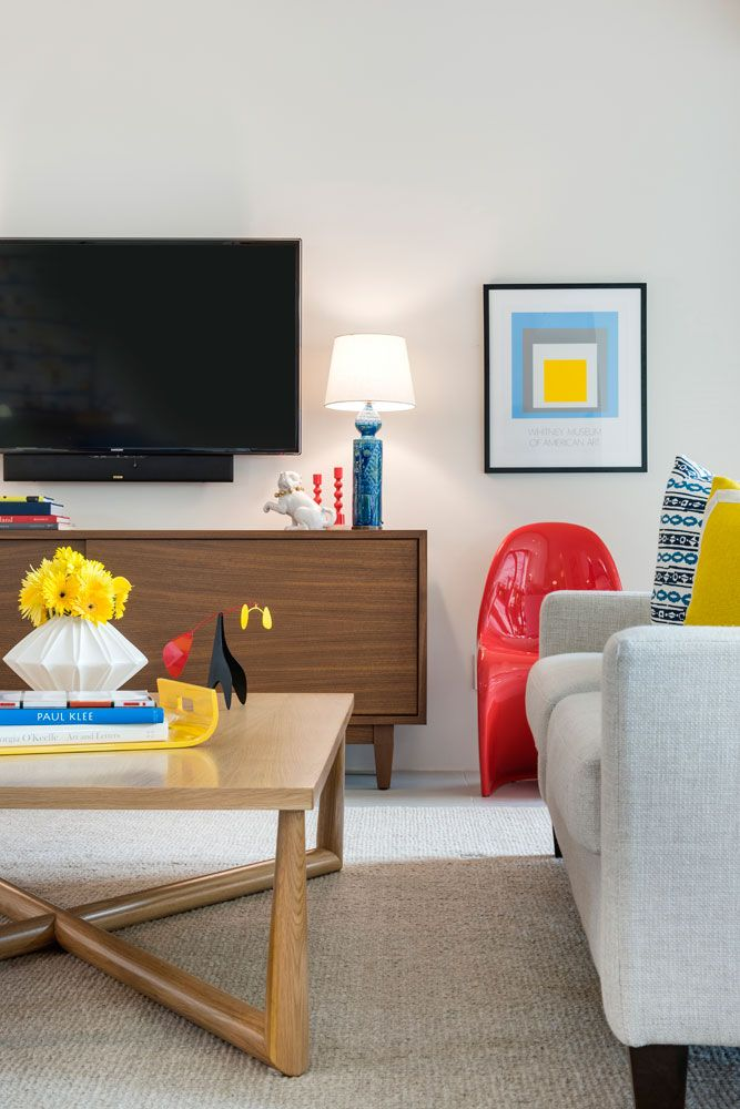 Electric living room design filled with color