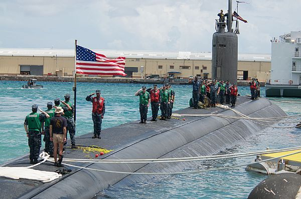 Sailors aboard the Los Angeles-class attack submarine USS Columbus (SSN 762) shift colors after arriving in Apra Harbor.