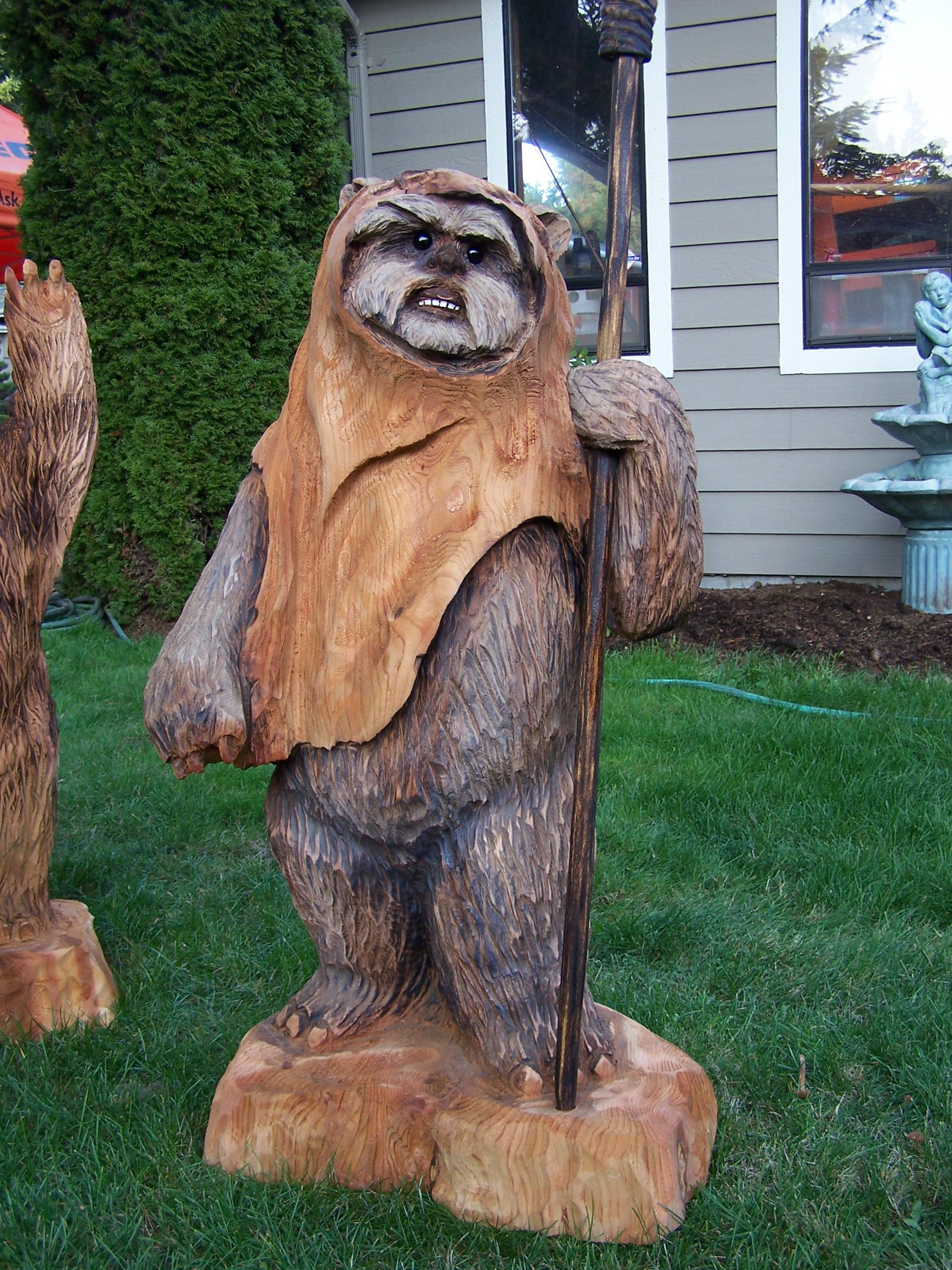 Chainsaw carving star wars figures for sierra snow park