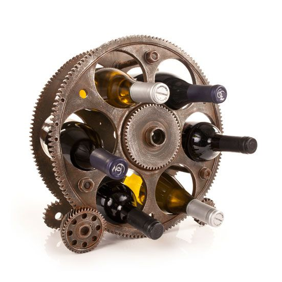 Reel Deal Wine Rack  This one goes for mega impact with eye-catching industrial style. Made of oversized reels and gears, it demands attention—and to be filled with six bottles of your favorite vino.