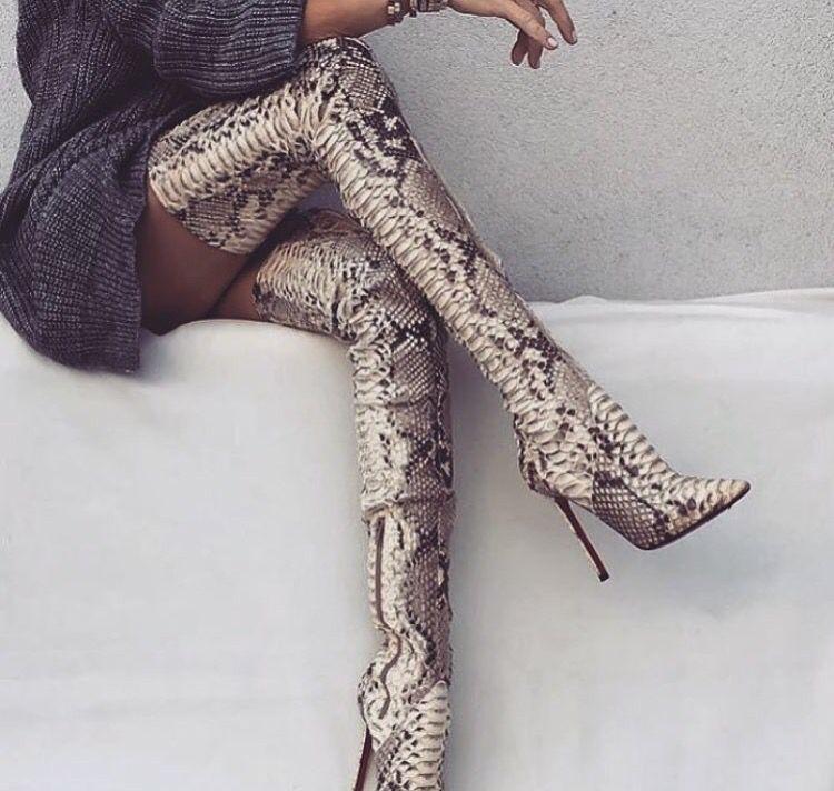 Seductive snake skin thigh high boots
