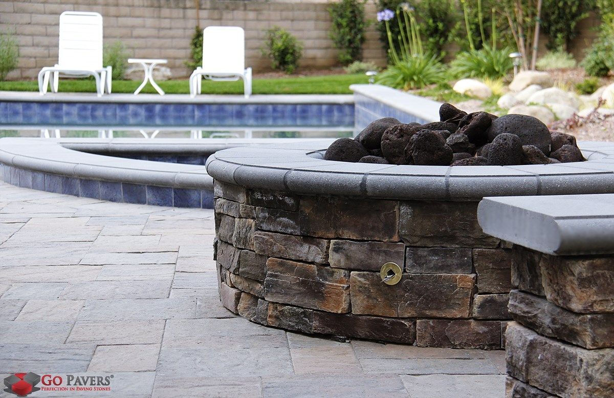 gray and brown paver stones and firepit pavers compliment the blue rh pinterest com