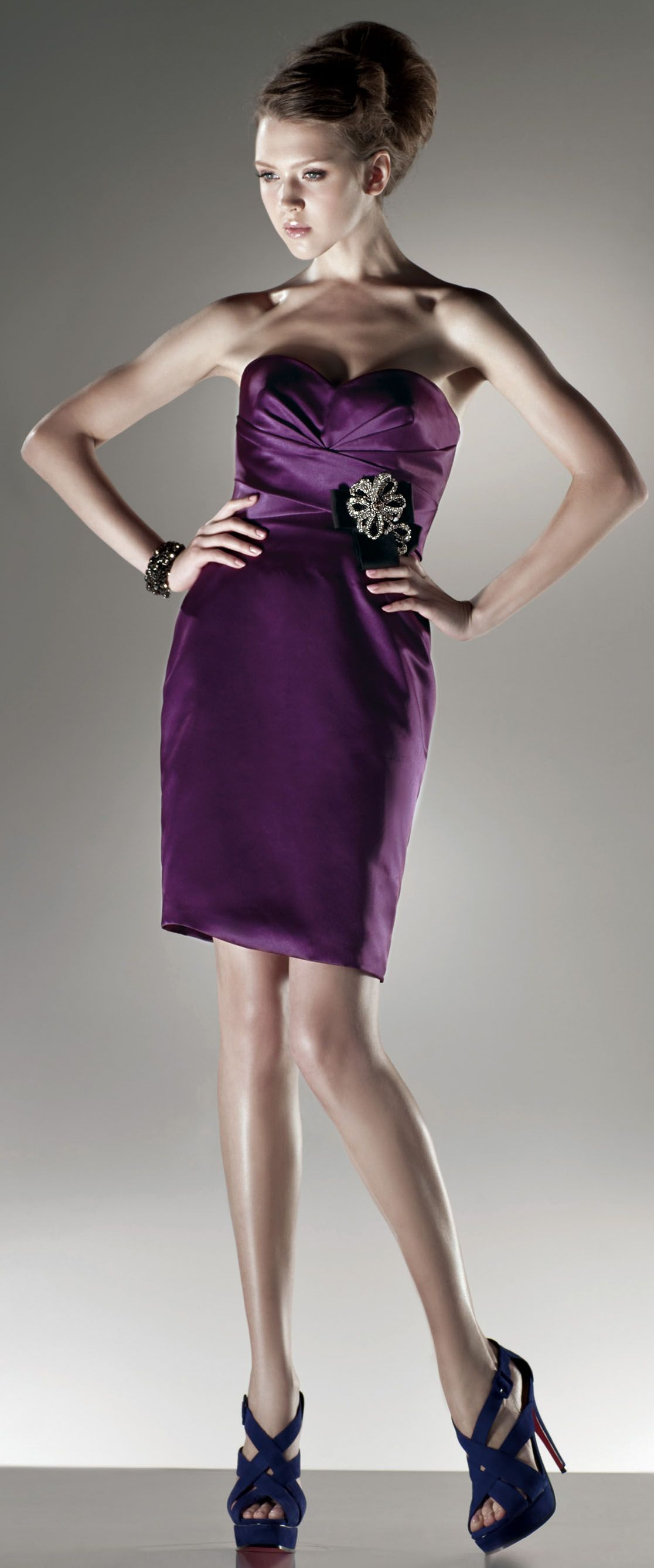 I like the eggplant color of the dress with the navy blue color of ...