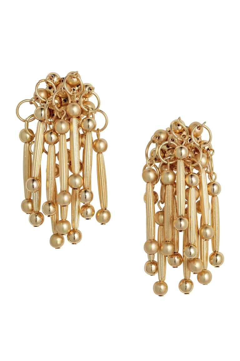 Round earrings: Round metal earrings decorated with round and rectangular plastic beads. Length approx. 6.5 cm.