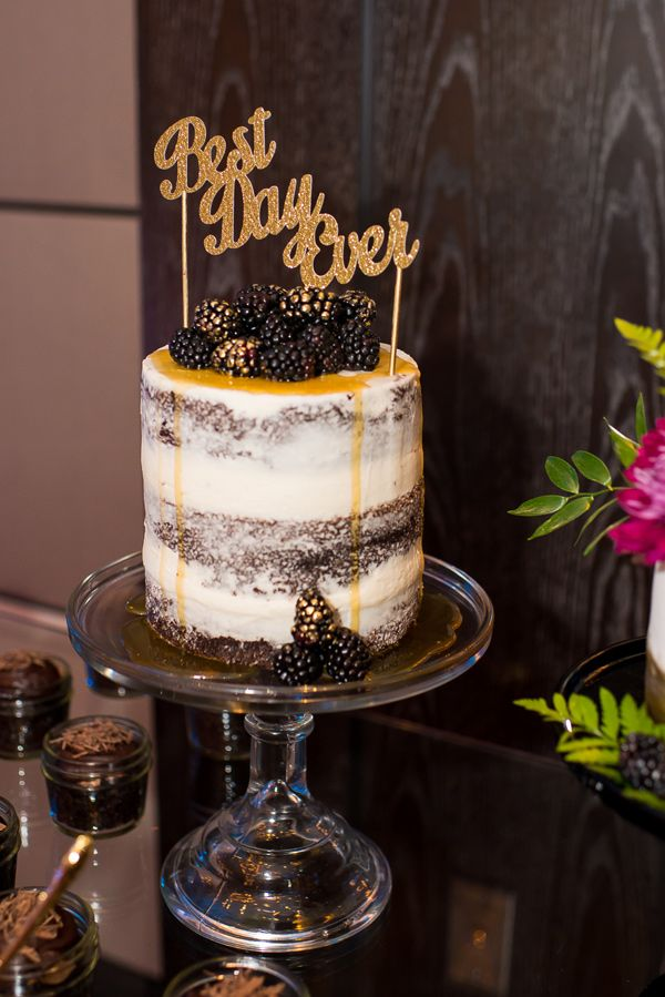 glitter cake topper - photo by Andrea Elizabeth Photography http://ruffledblog.com/wedding-inspiration-with-a-vintage-english-theme #weddingcake #cakes