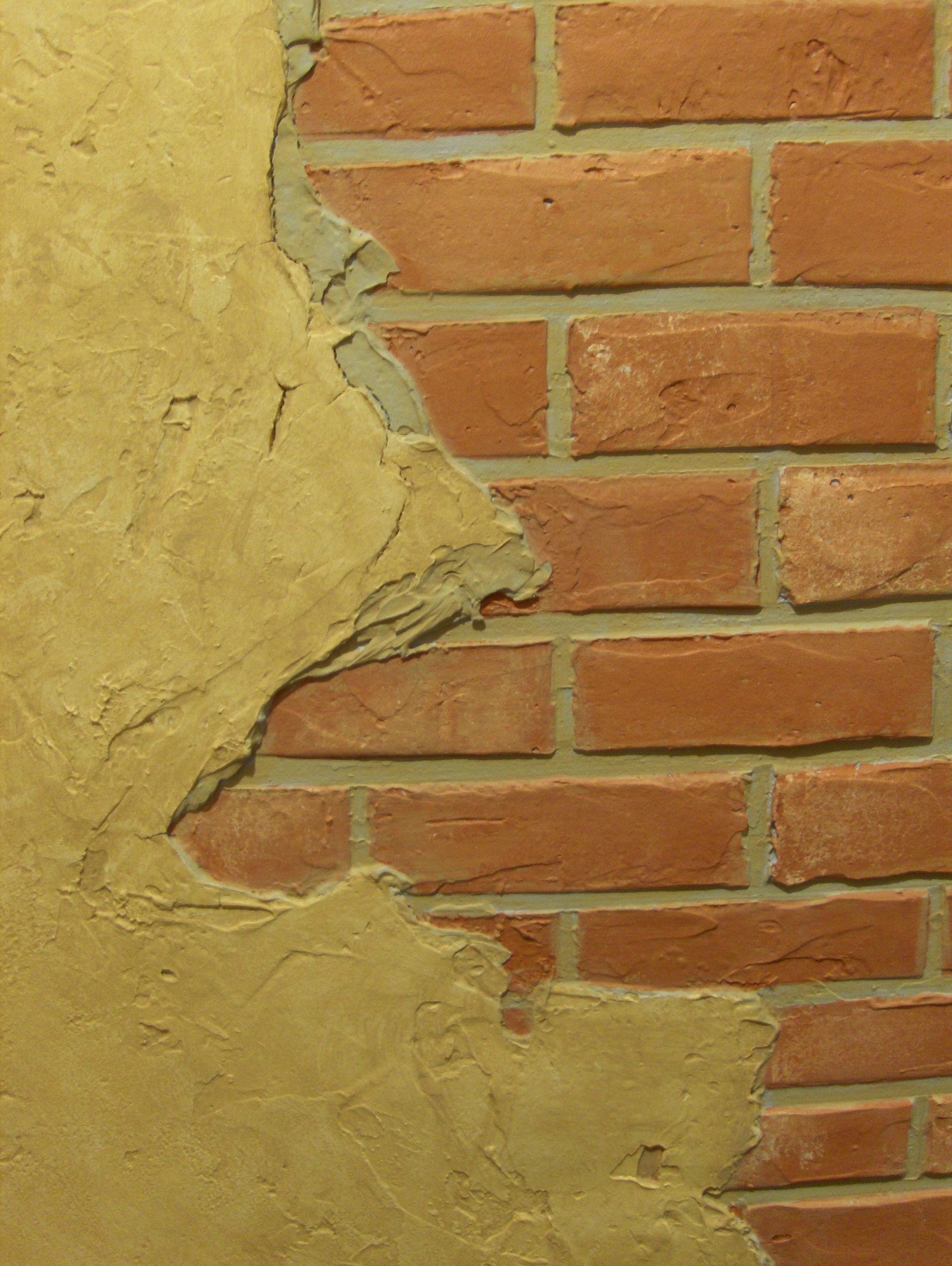 Faux brick with faux plaster chipped off. | Brick and stone walls ...