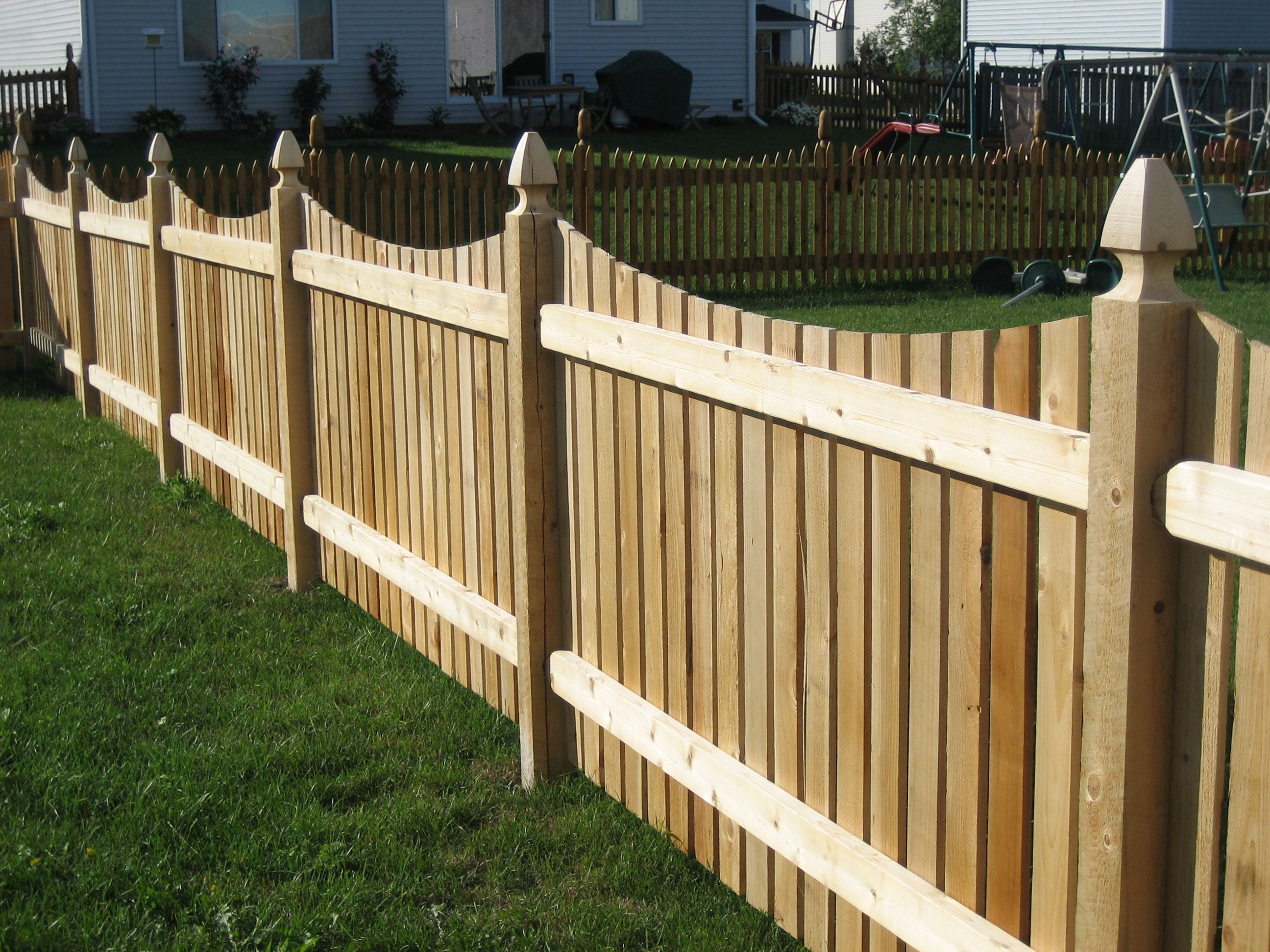 Cut scallop picket fence with carved French Gothic post tops | Cedar ...