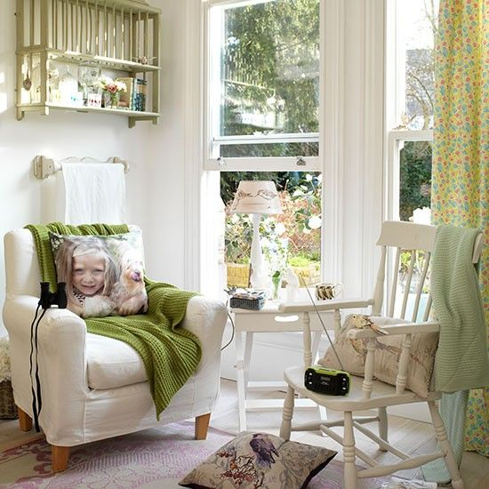 Laid-back white country living room with green accessories ...