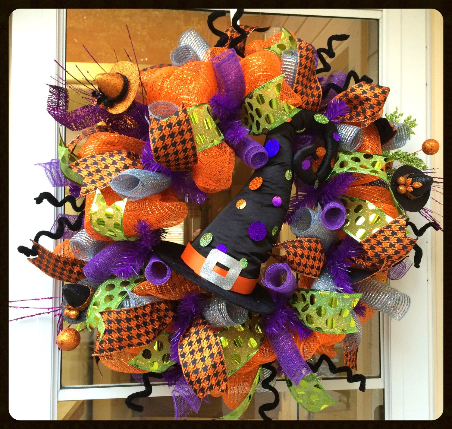 A personal favorite from my Etsy shop https://www.etsy.com/listing/244607988/whimsical-halloween-wreath-cute-witch