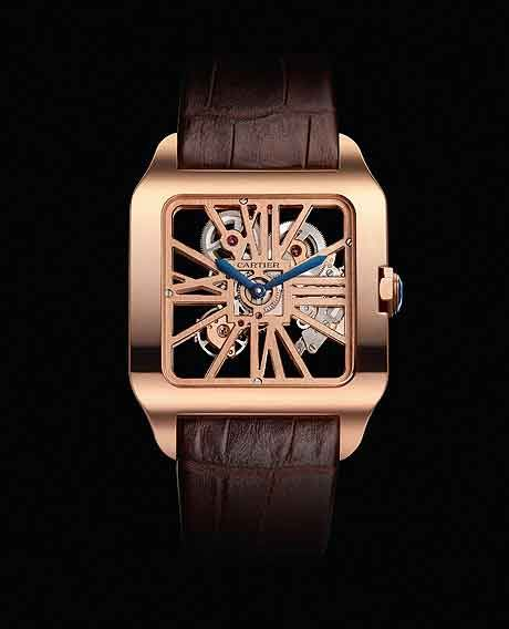 Cartier Santos-Dumont Skeleton Rose Gold. The blue sword-shaped hands and blue faceted sapphire in the winding crown add a touch of bright color, and the brown alligator leather strap completes the package.