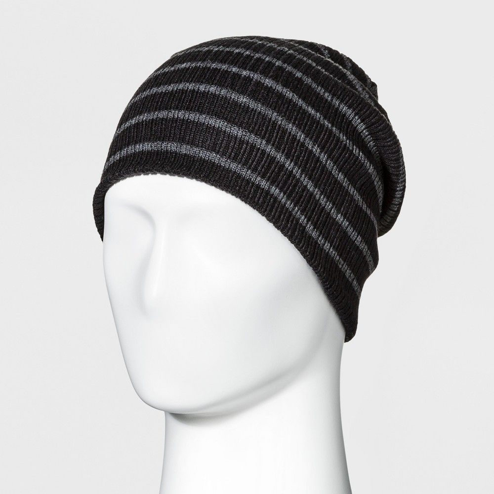 e615b6095c2 Keep your head warm without sacrificing your style with this men s  Reversible Striped Beanie from Goodfellow and Co. This solid-color beanie  features ...