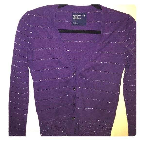 Long sleeve cardigan Beautiful purple long sleeve cardigan. Sparkly stripes detail. 57% cotton 34% nylon 9% other fibers American Eagle Outfitters Sweaters Cardigans