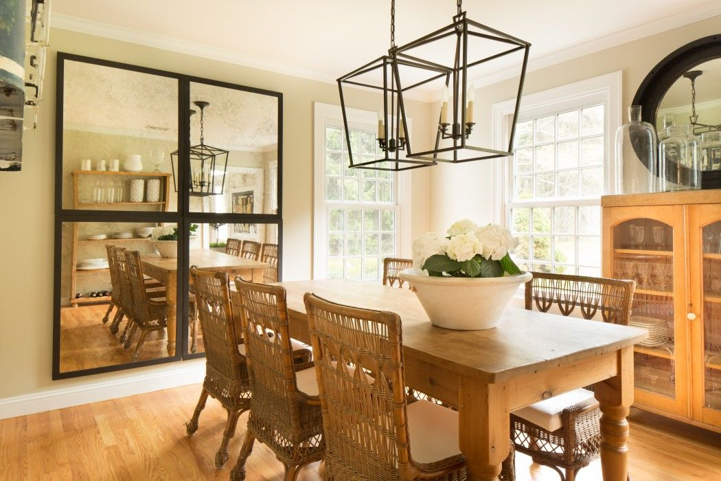 Cottage dining room features a pair of
