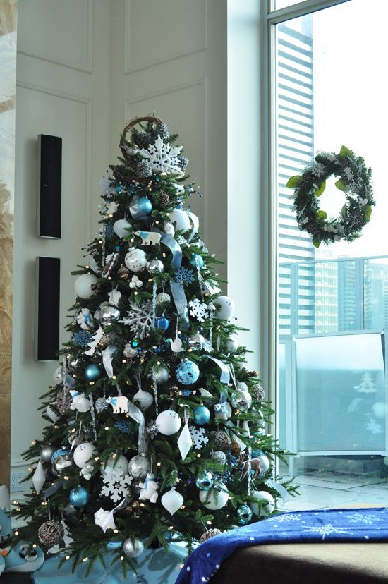 Winter Forest - Touches of sparkly silver and frosty blue unify the - blue and silver christmas decorationschristmas tree decorations