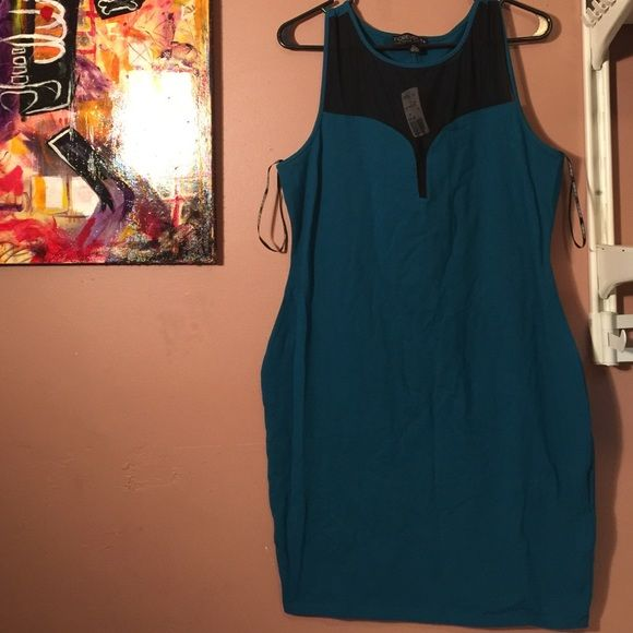 Short Bodycon Dress Navy blue in color, this dress has a mesh covered plunging neckline and hits right above the knees. Very soft cotton dress. Forever 21 Dresses Mini