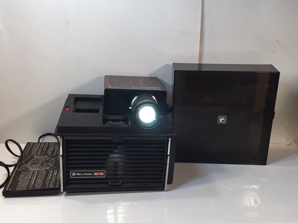 vintage bell howell slide cube projector with remote