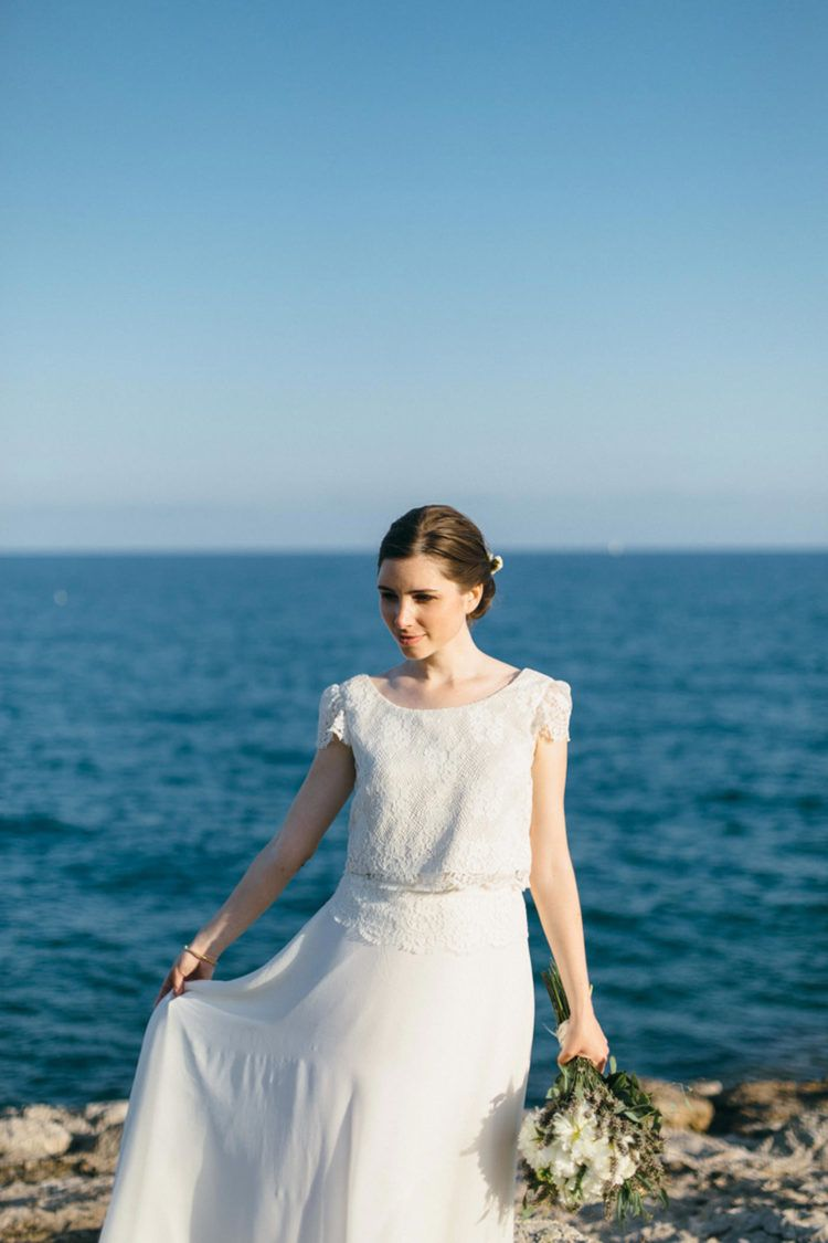 The bride was wearing a chic separate with a lace bodice with cap