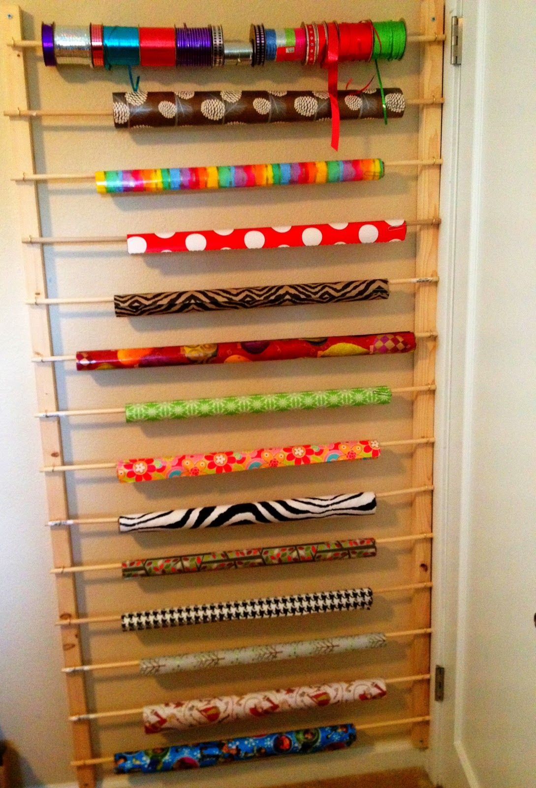home made is easy diy behind the door wrapping paper ribbon storage rh pinterest com