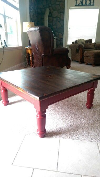 DIY furniture. Great coffee table finished with a distressed red base and a dark