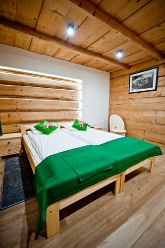 U Tatar�w Suche Offering a children's playground and ski storage space, U Tatar?w is situated in Suche in the Lesser Poland Region, 5 km from Zakopane. Free private parking is available on site.  All rooms are fitted with a flat-screen TV.