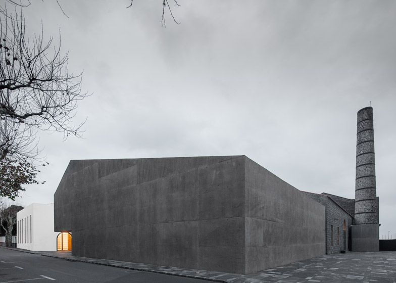 Contemporary arts centre on a Portuguese isle contrasts volcanic stone with concrete.