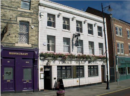 Turks Head Hotel Is An Old Pub Built In 1850 With A Listed Front Facade Of White Tiling Located Close To The Sea At Tynemouth There One Room