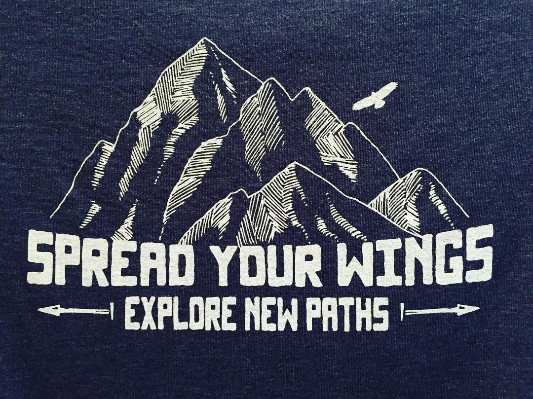 Spread Your Wings - Explore New Paths tee from Gusto Graphic Tees.