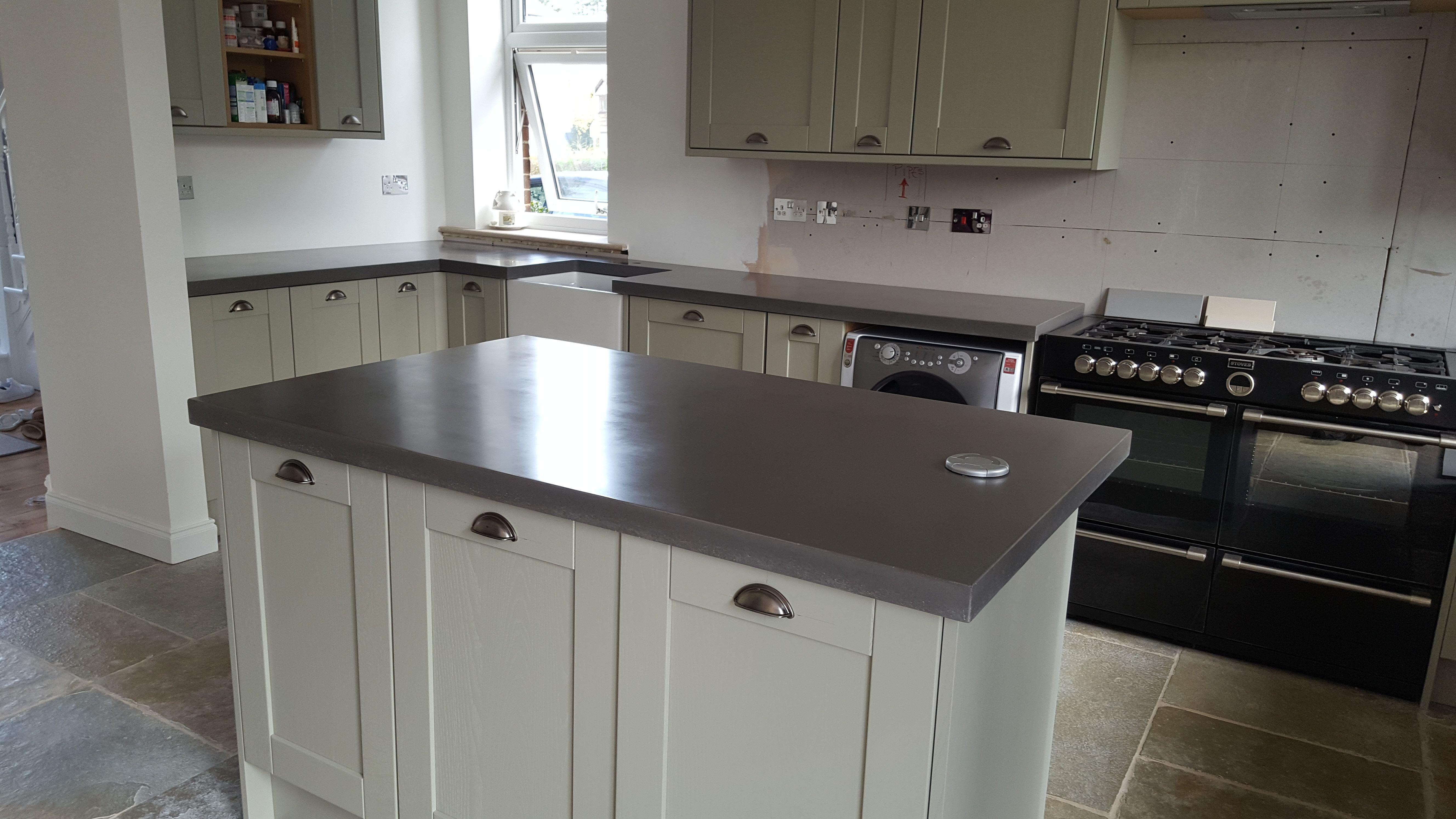 pastel shaker kitchen with concrete worktops. kitchen